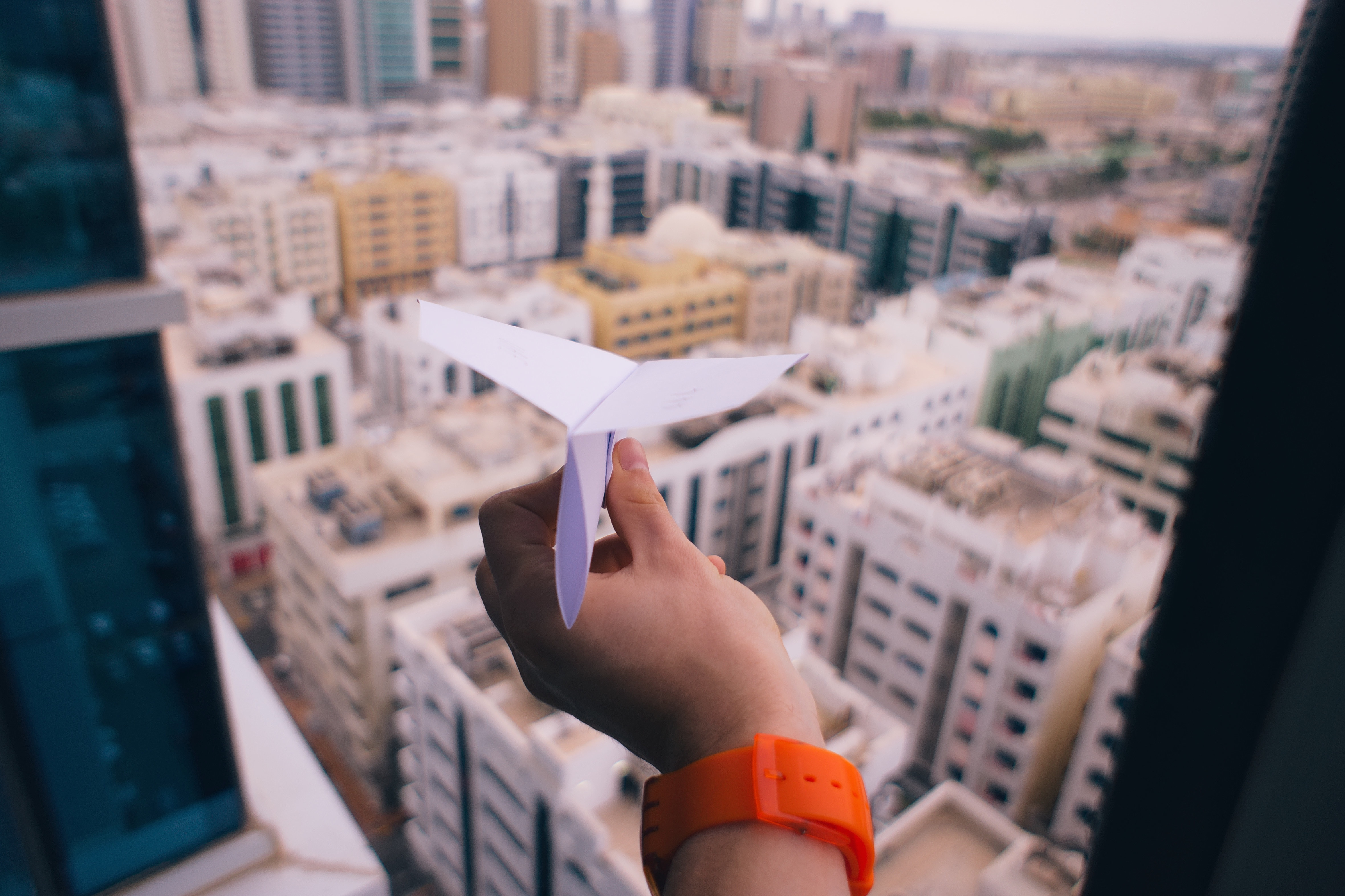 Paper airplane with city view