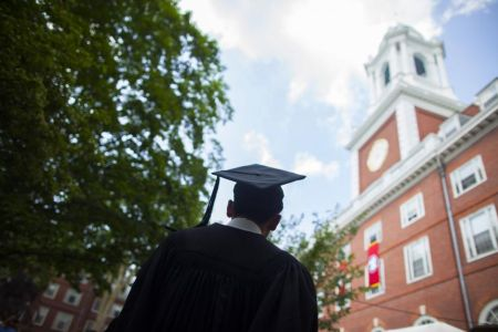 Graduate in cap and gown at Harvard