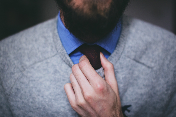 A man adjusting his tie