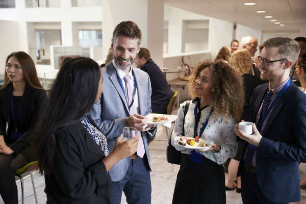 A group of people talking at a networking event