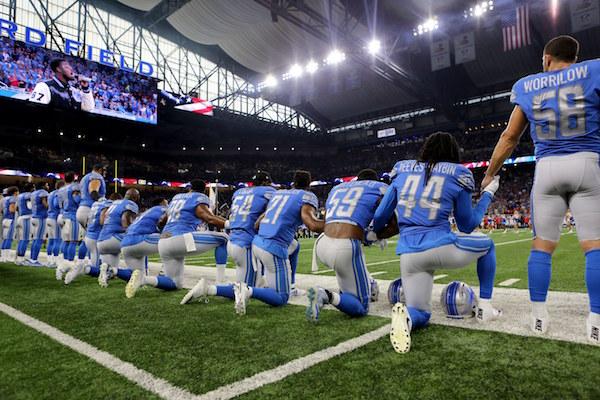 detroit lions take a knee