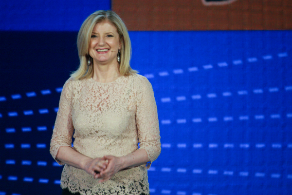 Arianna Huffington giving a presentation onstage