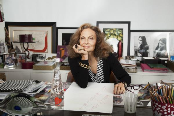 Diane von Furstenberg sitting at her desk