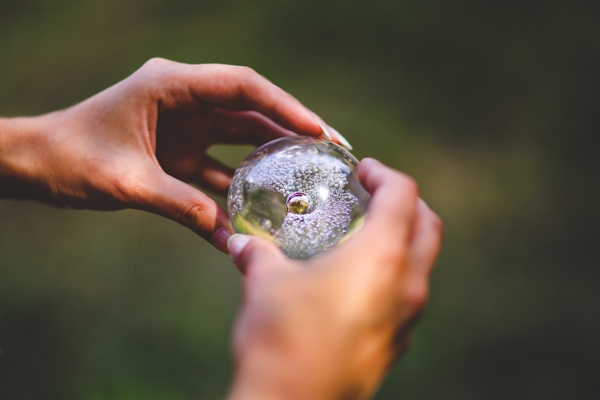 Hands holding crystal ball