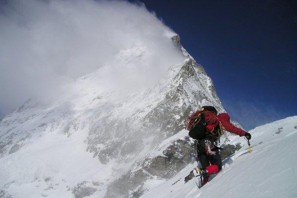 Mountain climber on the Matterhorn in the snow