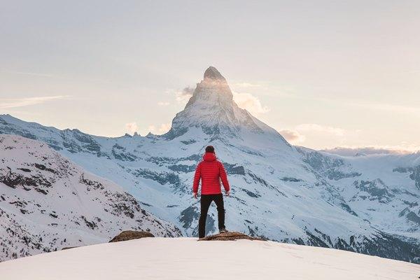 Man looking at mountain and lake