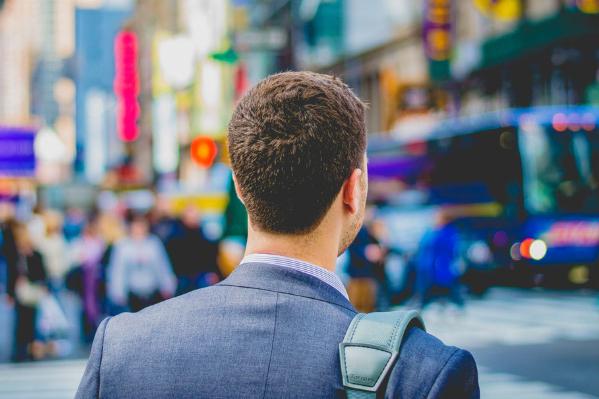 back of guy on street