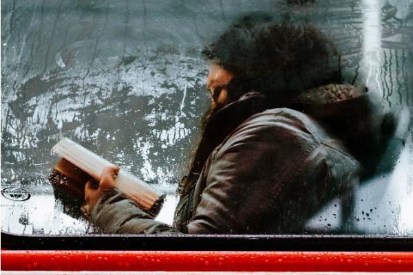 Woman reading subway