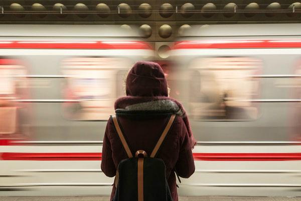 woman looking at subway