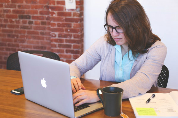 frustrated woman on laptop
