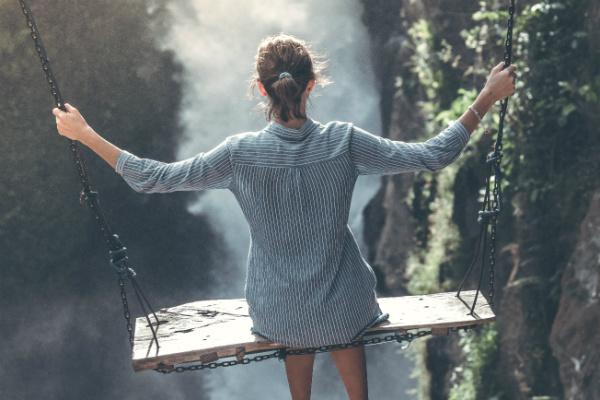 woman swing ravine